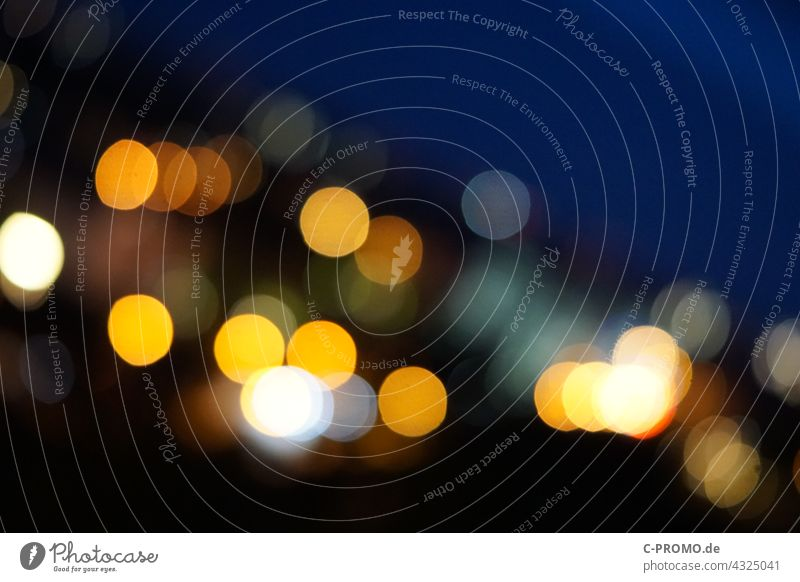 Points of light at night Night light points Point of light blurriness Abstract Blue Yellow Town