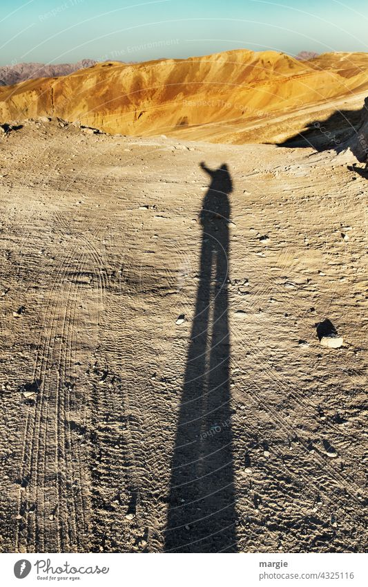 occupied | here I stand Shadow Exterior shot Desert Nature Landscape Vacation & Travel Skid marks Far-off places Stony mountains middle east Sand Adventure
