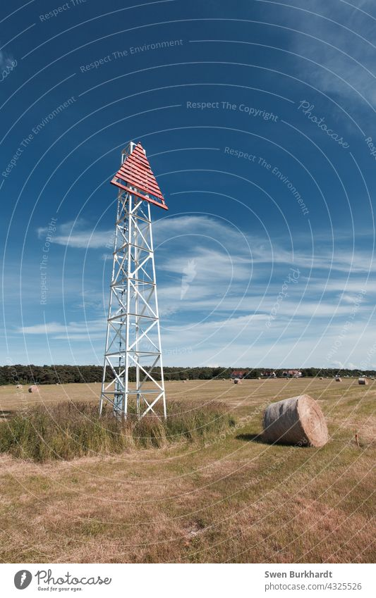 Sea sign stands on field next to a roll of hay against blue sky Navigation mark Blue sky Sky Summer Hay Hay bale Harvest Autumn Summery Clouds Tower Dirty