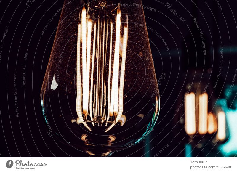 The good old light bulb - as LED version ;-) Electric bulb Light Filament Colour photo Illuminate ceiling light Lamp Glass Electricity Deserted Dark Close-up