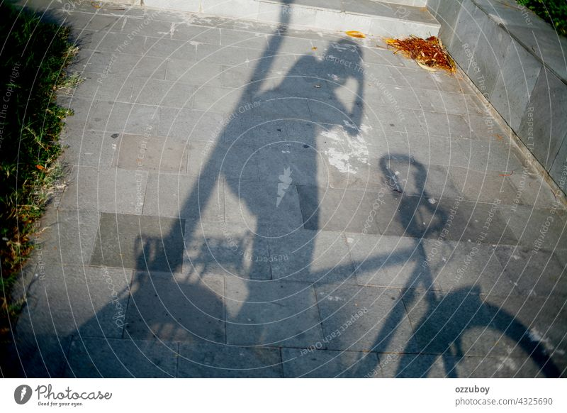 shadow of cyclist taking photo bicycle sport cycling road transportation person leisure activity bike outdoors street horizontal action exercising ride shade