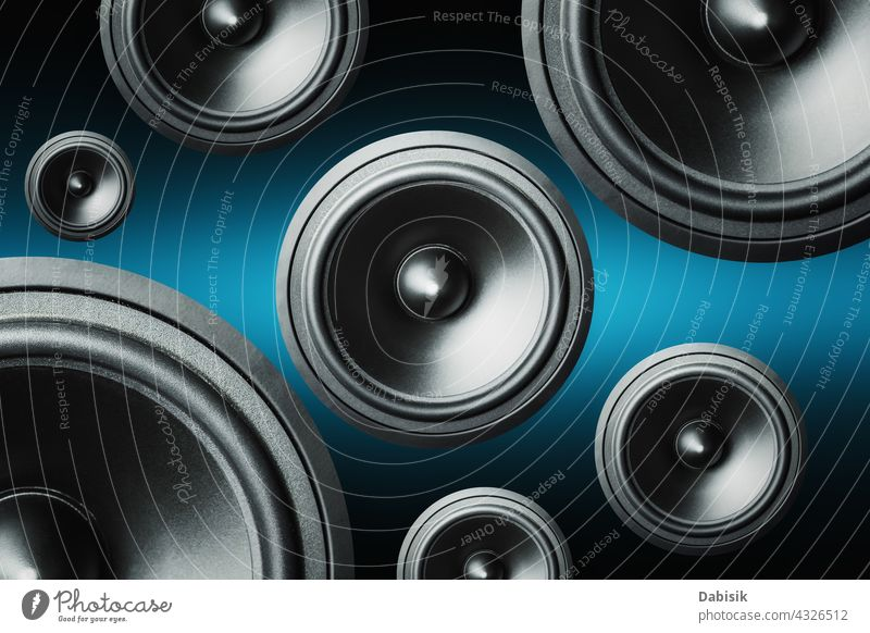 Many audio speakers on dark background music dynamic subwoofer loudspeaker sound volume acoustic stereo circle collage equipment design art computer box