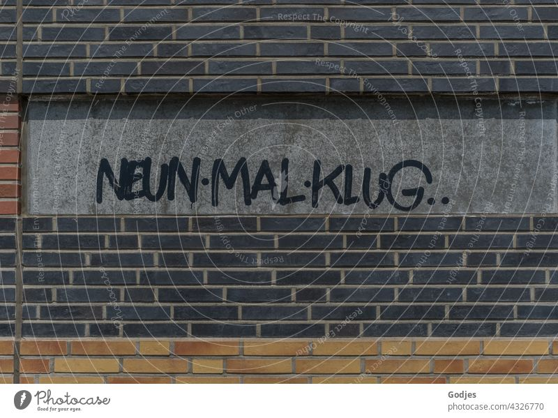 NeunMalKlug writing on the wall of a university building lettering Graffiti Characters Wall (building) Wall (barrier) Exterior shot Copy Space top