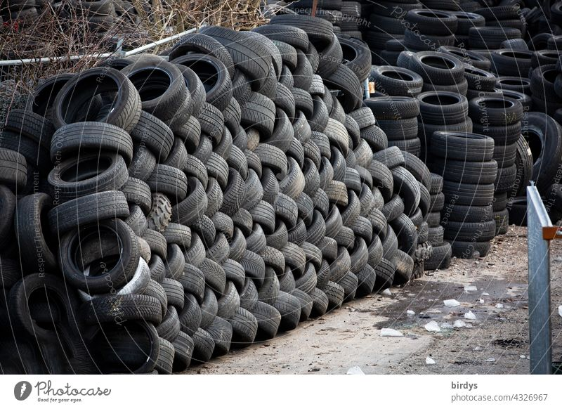 Stacked car tires in a scrap tire dump Car tire scrap tyres Tyre landfill stacked Waste tyre landfill Disposal Trash Recycling waste rubber abrasion Wear Tire