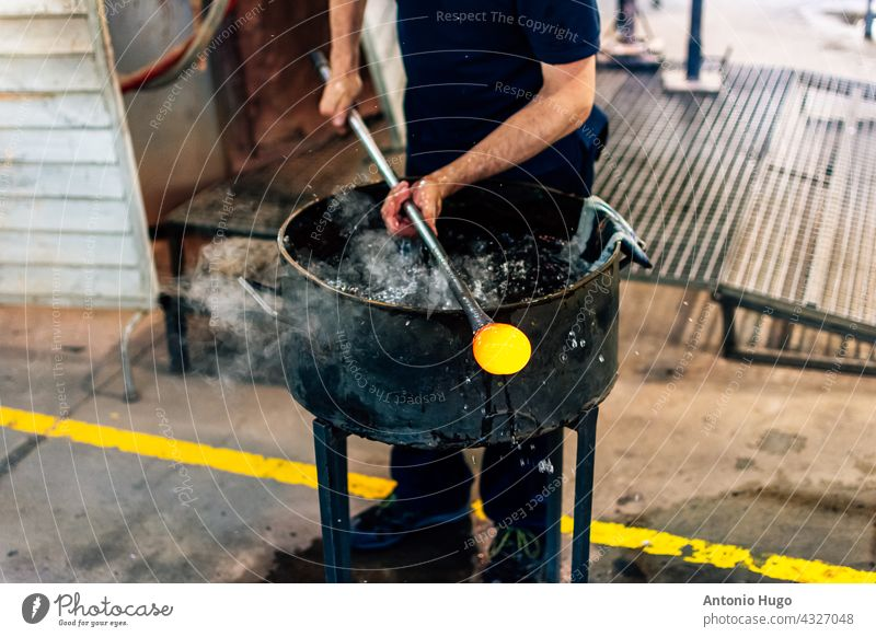 Glassworks glass manufacturing, process of forming a decorative vase artisan working piece glasswork artist material blowing making factory workshop heat fire