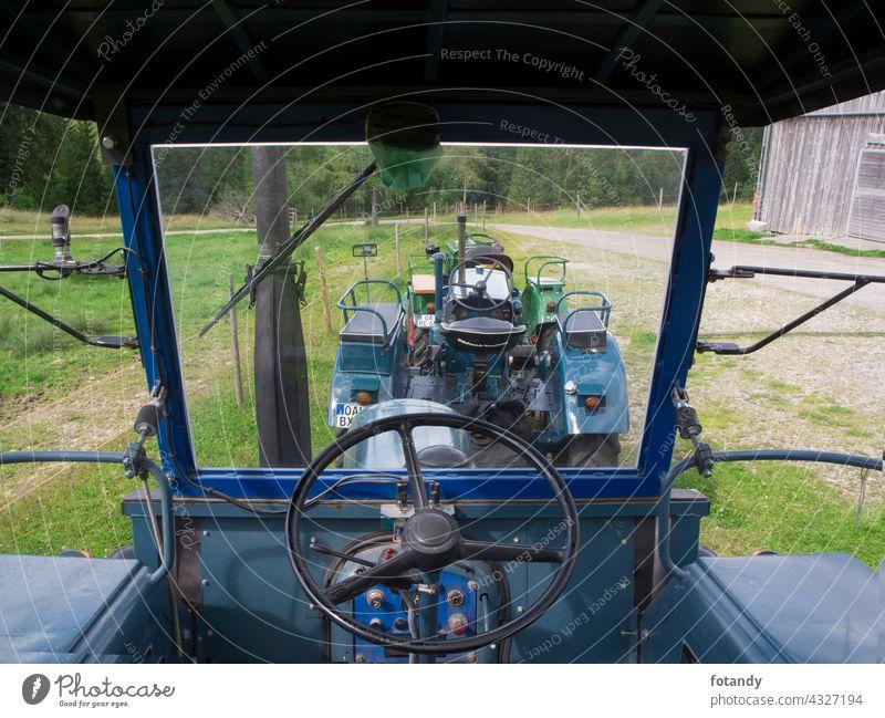 Blue restored tractor inside wide angle Antrieb Bulldog Deutschland Fahrerhaus Fahrersitz Hanomag Innenansicht Landmaschine Landwirtschaft Lanz Lenkrad
