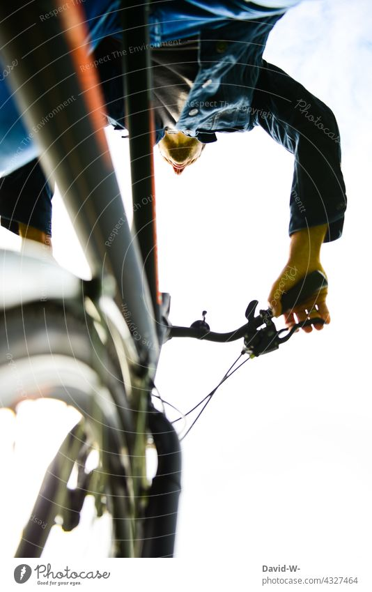 Man riding a bicycle Cycling Bicycle Wheel especially Movement Driving Cycling tour Lanes & trails In transit Mobility Worm's-eye view