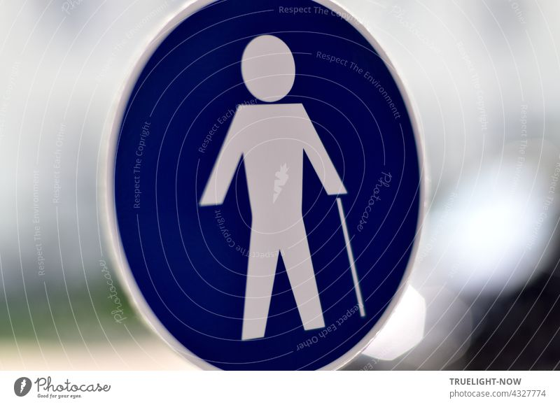 There's a man walking with a cane. He is white, around him only blue. What is missing is the woman. Pedestrian walkway Transport Road sign Blue White commanded