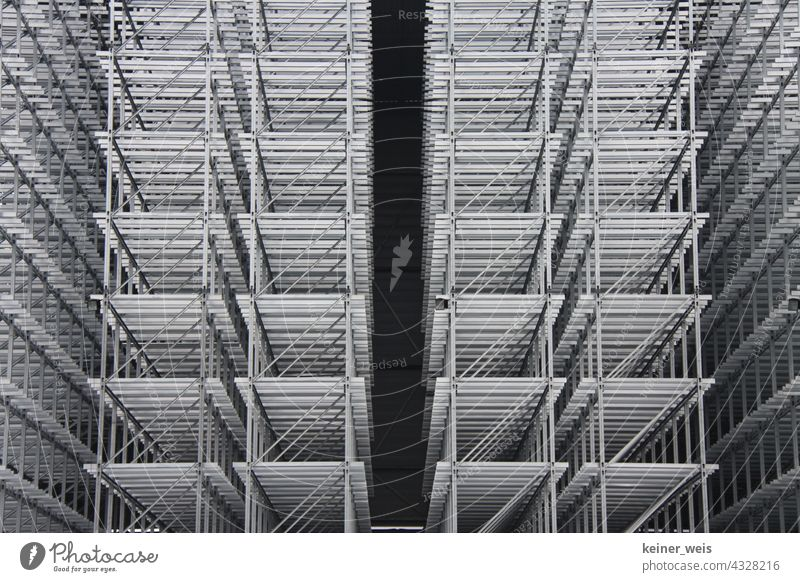 A high-bay warehouse under construction high-rack Construction site Steel Metal Deserted Structures and shapes Industry Storage Economy Production