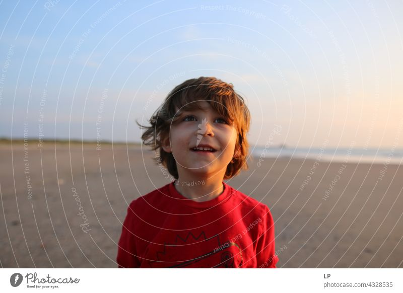 boy smiling and looking up Education To enjoy Optimism Religion and faith Connection Positive Innocent Playful showing nature Meditation Senses Calm