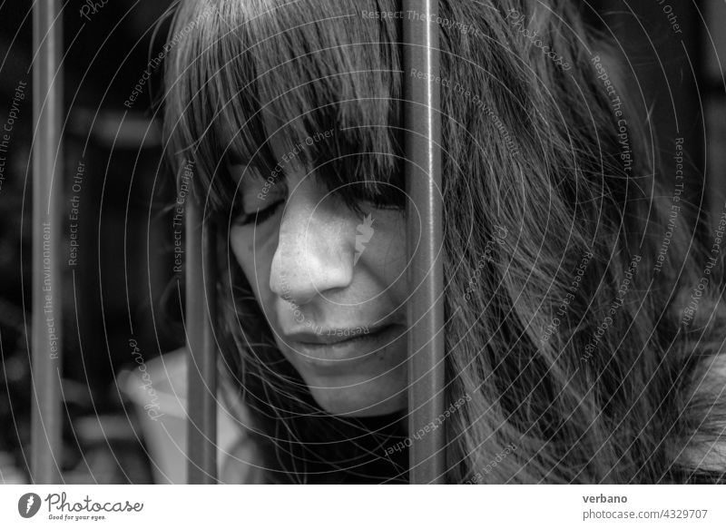 monochrome bw portrait of a woman between iron bars beautiful female beauty happy smile black person happiness face ethnic background american pretty studio