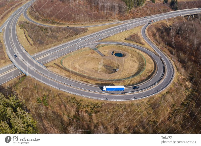 a truck on a highway landscape from above truck on highway cars speeding transportation transportation from above modern highway concrete highway exit