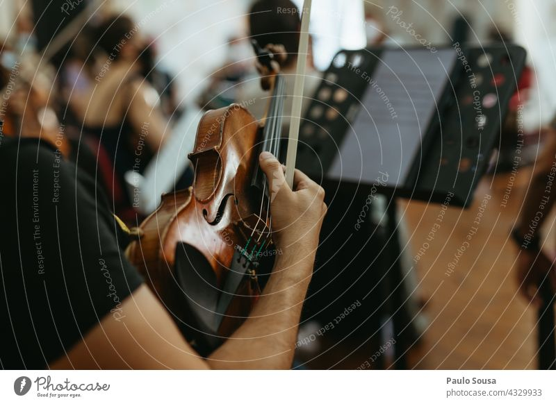Musician holding violin Violin Violinist Musical instrument Unrecognizable Listen to music Detail Art Orchestra Classical Musical instrument string Colour photo