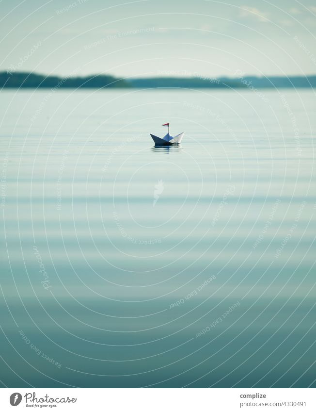 Calm lake with small paper boat Freedom Sunbeam Sunlight coast Sailboat Target Paper boat Navigation Infancy Beach Summer vacation Water Nature Environment