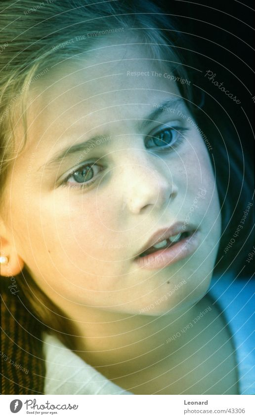 attention Child Girl Human being Laughter Face Sun Shadow blue eyes sight