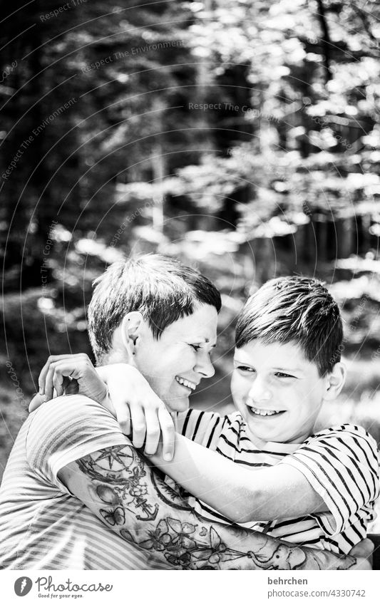 two who love each other Contrast Sunlight blurriness portrait Light Day Close-up Exterior shot Motherly love Happy Love Son Together Trust Contentment Happiness