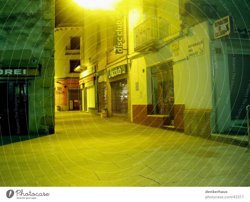 Alone in Spain Empty Light Play of colours Yellow Store premises Alley Places House (Residential Structure) Calm Architecture Street Loneliness
