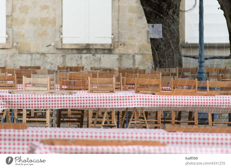 Rows of chairs and tables on a marketplace await guests festival party folk festival food and drink Eating celebrations empty chairs Table Rustic Tradition