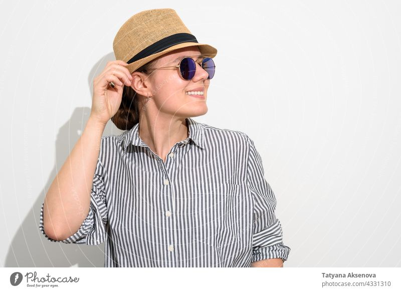 Smiling woman in hat and sunglasses person summer female happy vacation caucasian adult lifestyle cheerful looking smiling brunette smile straw carefree enjoy