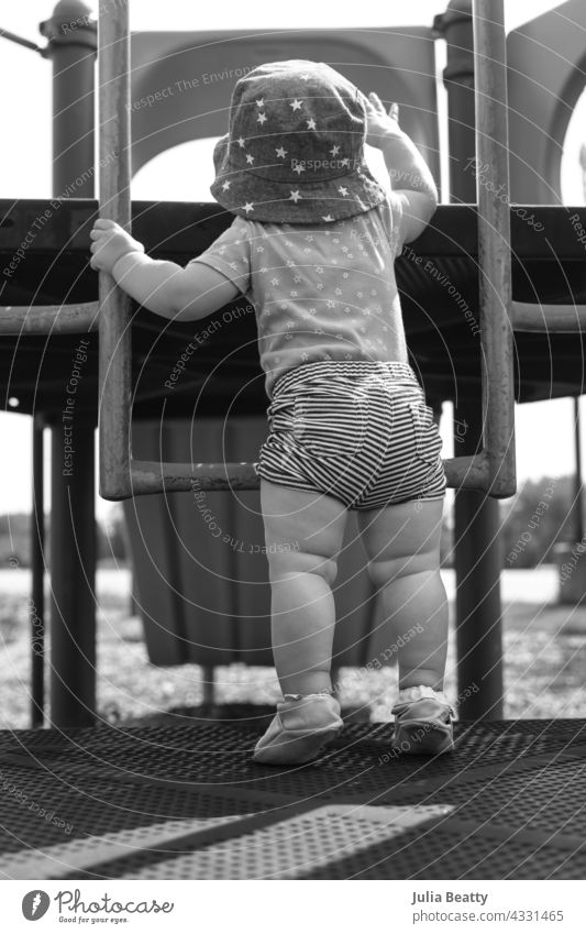 13 month old baby trying to navigate a ladder at a playground; reaching and pulling up to tip toes pull up tiptoe learn learning hold vestibular sensory input