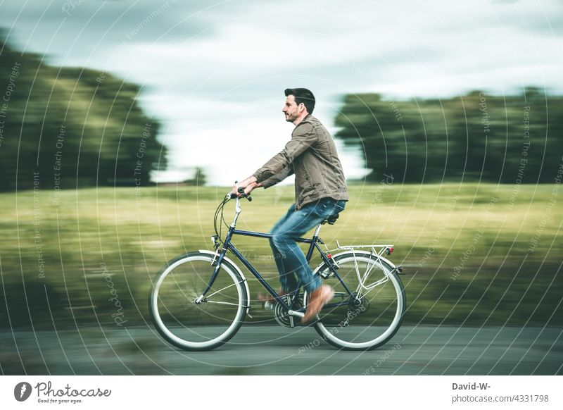 Cycling through nature Bicycle Man Driving Nature Movement Speed Healthy Mobility Cycling tour Leisure and hobbies Trip Lanes & trails Eco-friendly