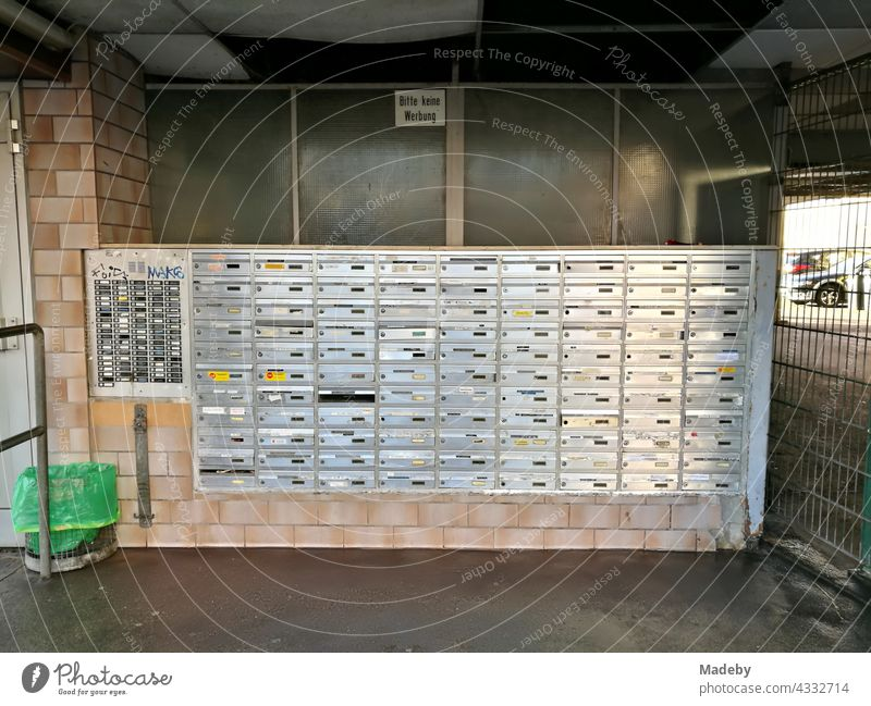 Mailbox system on a large apartment building in the city centre of Offenbach am Main in Hesse Letter (Mail) letterbox system Brass Metal splendour