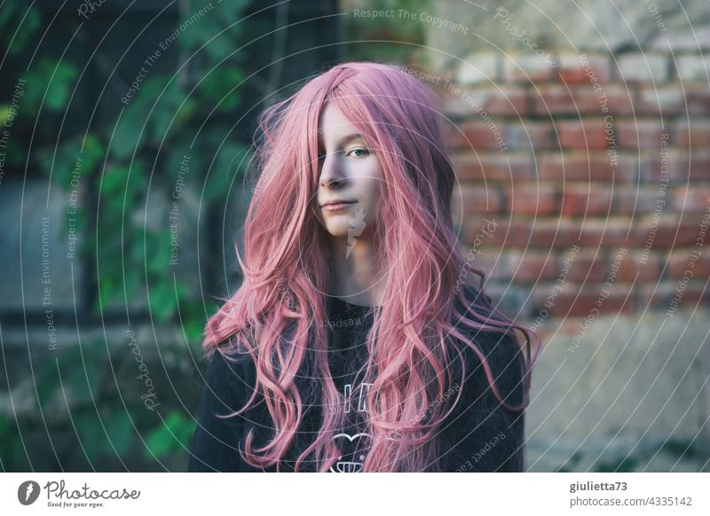 Portrait of a teenage girl with long pink hair Colour photo Girl Long-haired 13 - 18 years Hair and hairstyles Puberty Youth (Young adults) Feminine