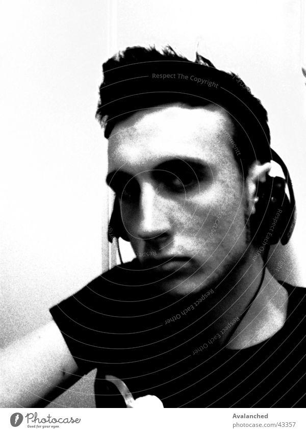 Man White Black Posture Disc jockey Facial expression Headphones