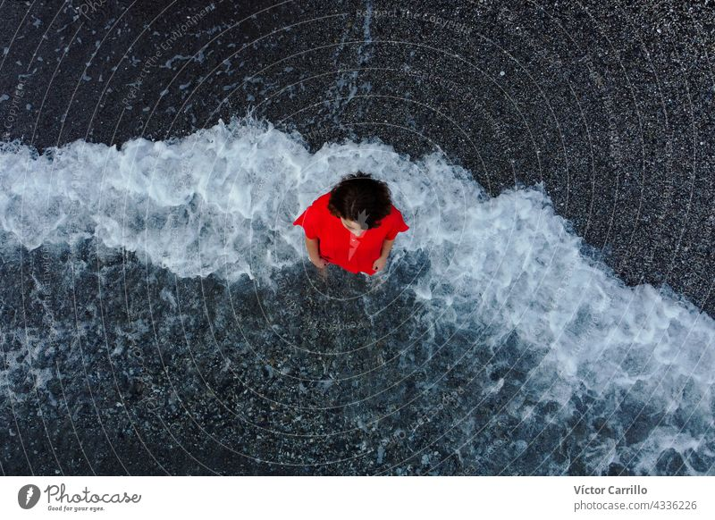 top view of a woman in a red dress  with sea foam background water wave beach ocean blue nature waves summer splash spray coast recreation sky outdoors model