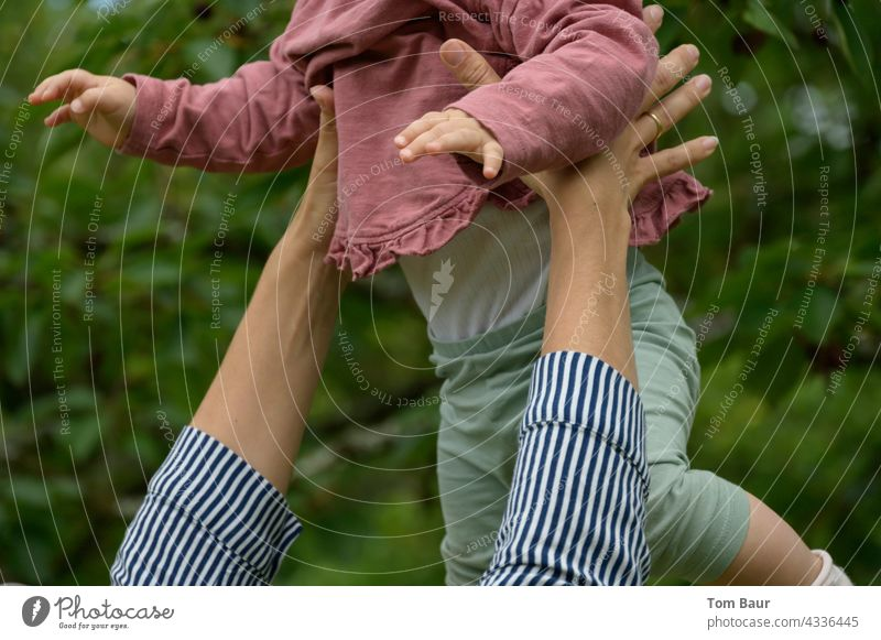 Fly angel fly! Mother throws her child in the air and catches him again Child Baby Toddler cute Throw Throw in the air Playing Flying Safety Joy Hand Catch