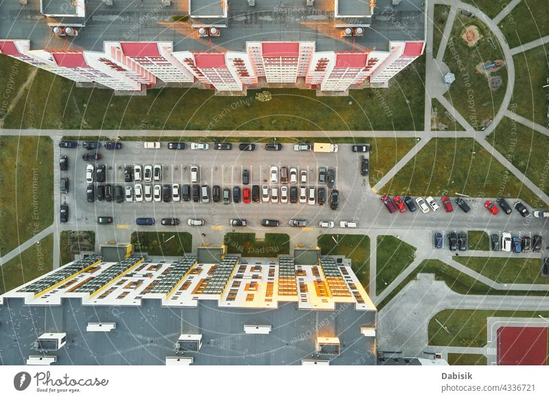 Aerial view of car parking lot near modern house building residential yard transport living sector parking space vehicle outdoor top asphalt street urban vacant
