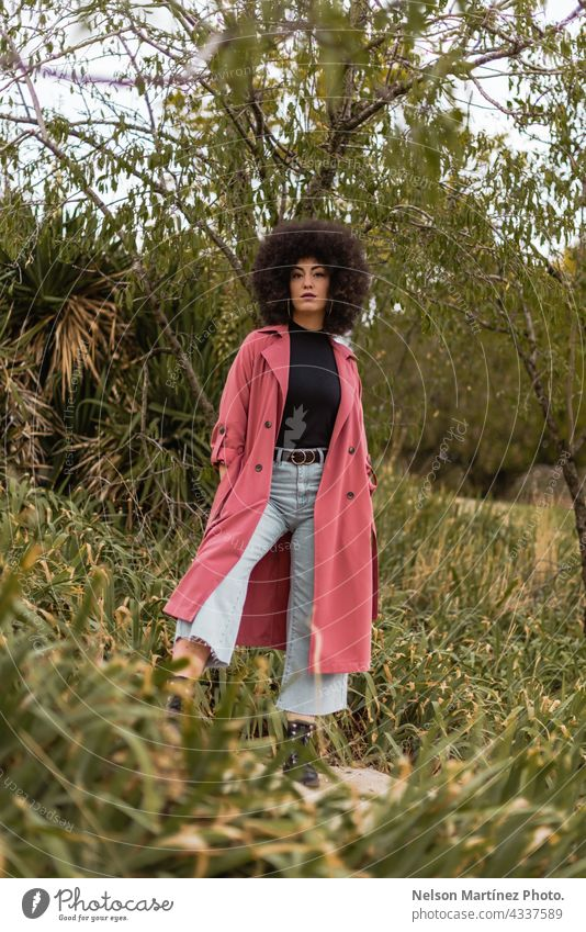 Portrait of a beautiful young mixed afro woman outdoors golden hour clothes weather person cute female nature people clothing stylish fashion ethnic lady coat