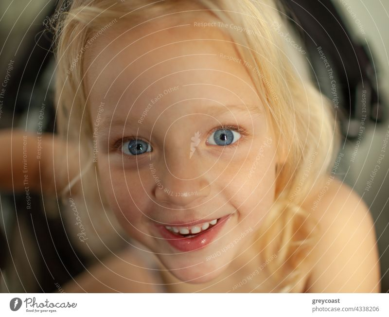 Looking at the world with a big smile portrait girl kid child people baby joy little home excited joyful toddler positive small cheerful childhood blue eyes