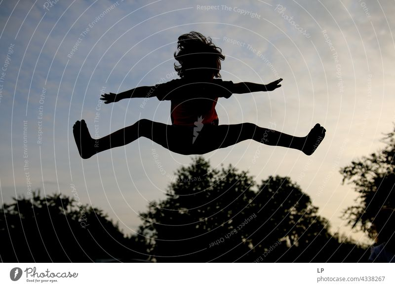 contrast silhouette of a child jumping above trees outdoor recreation Structures and shapes Playing Harmonious Well-being Neutral Background Day Beginning
