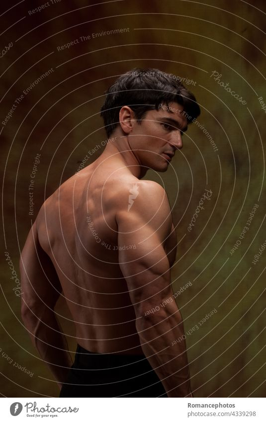 The sexy man shows off his strong muscles. hot guy stud hunk macho brazen muscular handsome heartthrob spooky vampire wicked stock images graphics inspirational