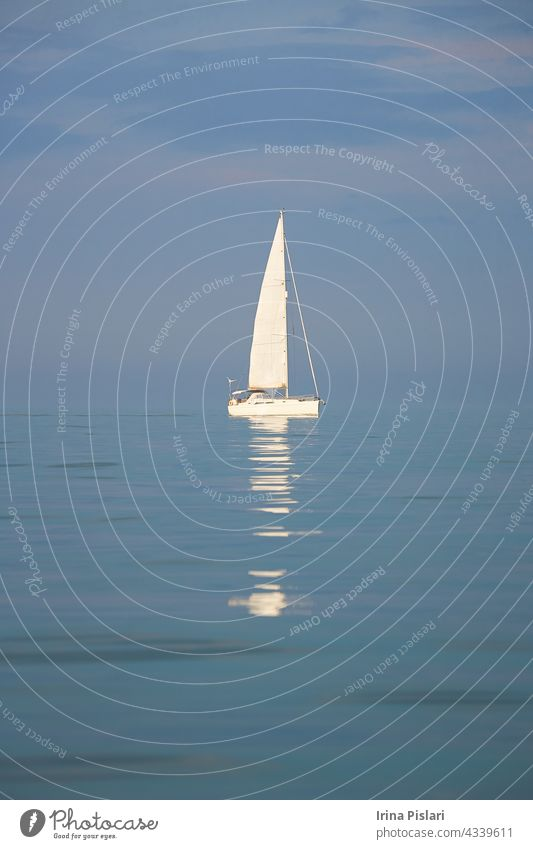 A yachts in the sea. beautiful blue boat bright cloud colorful creepy cruise england europe exhalation fishing fog harbor harbour haze holiday horizon horror