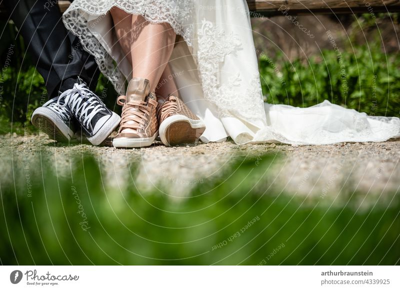Young wedding couple in sneaker shoes sitting on a bench in nature Wedding Love Couple Exterior shot Lovers Wedding couple Relationship Partner Matrimony 2