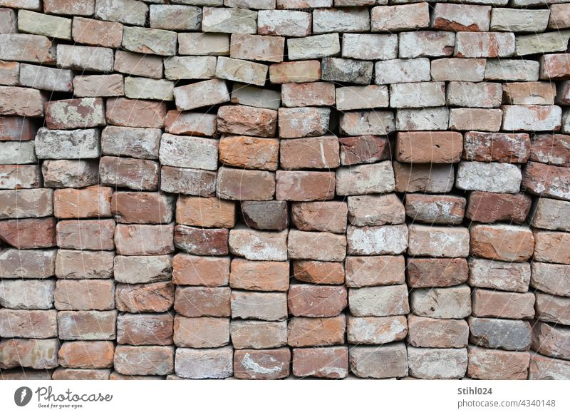 stacked bricks Brick Stack pile full-frame image Wall (barrier) Structures and shapes Pattern Deserted Exterior shot Stone Facade Brick wall Architecture