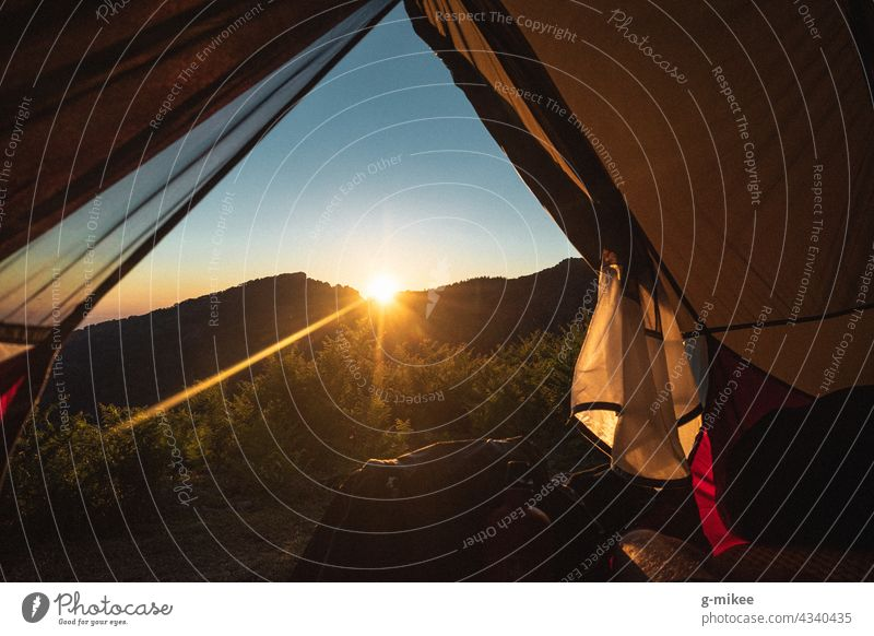 View from the tent: sunset in the mountain landscape Hiking Tent outlook Mountain Sunset vacation Freedom Summer travel Nature Landscape