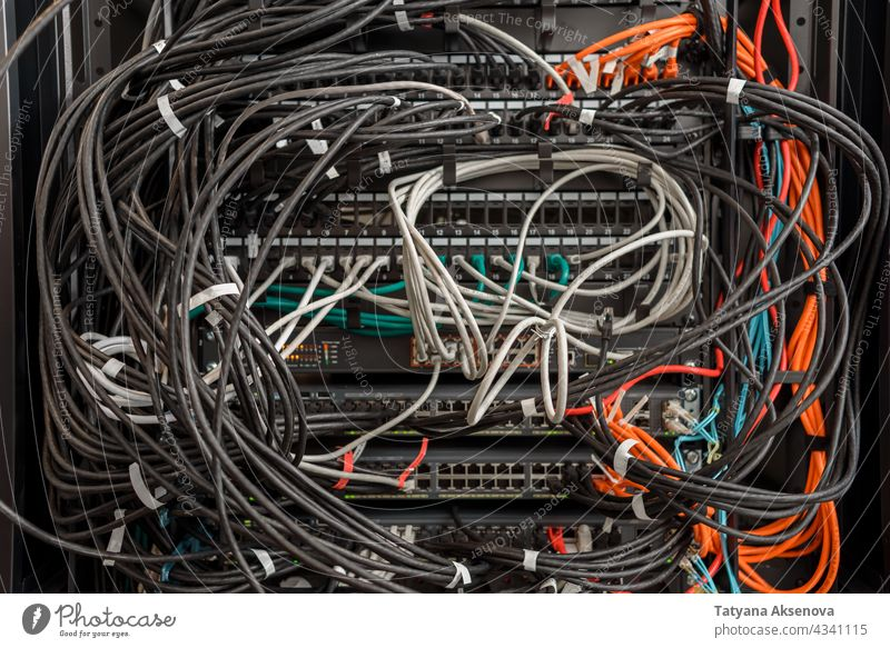 Working hardware in data center infrastructure server maintenance rack cables mess clutter replacing blade mounted fiber optics rj45 recovery working it job