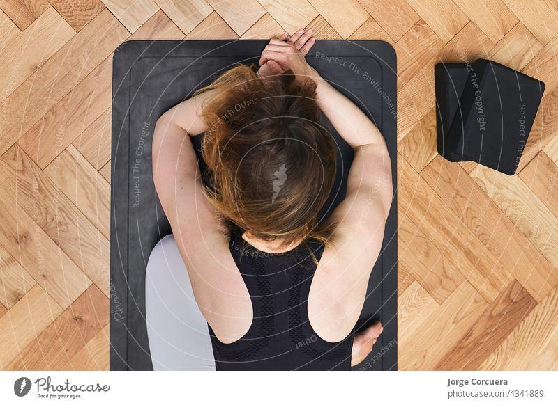 Yoga girls doing Anahatasana pose. Cenital Plane yoga exercise fitness flexibility active athletic balance body care class concentration floor freedom