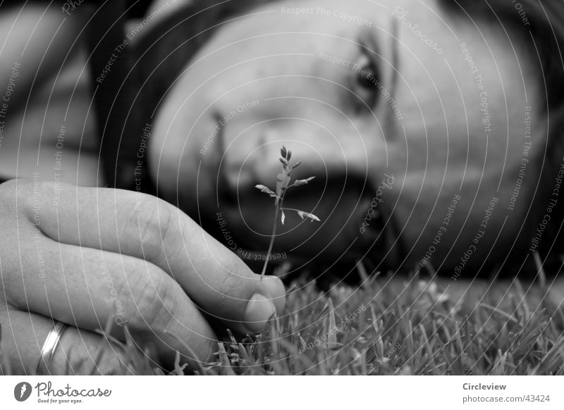 Not really sad. Woman Black White Grass Blade of grass Fingers Hand Grief Portrait photograph Black & white photo Lawn Head Face Sadness Circle Looking