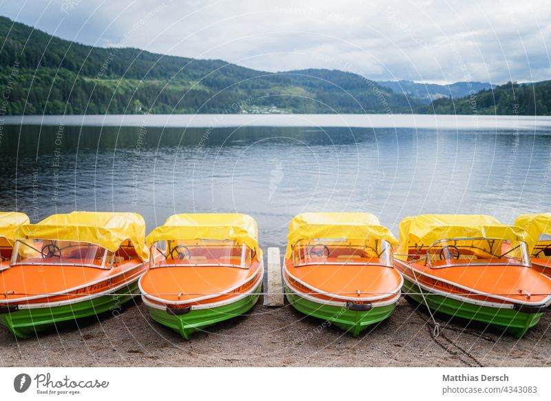 Pedal boats at the Titisee Pedalo Lake Lakeside vacation Vacation mood Vacation photo Vacation destination Black Forest Lake Titi