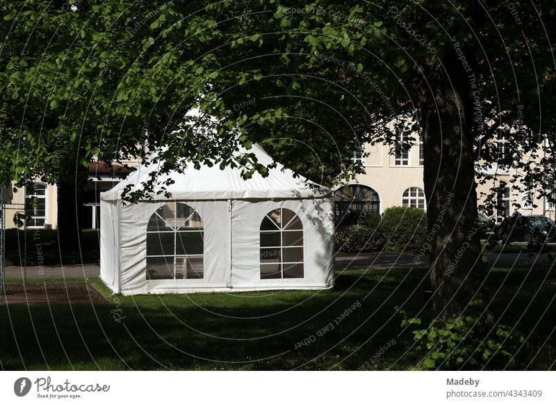 Waterproof party tent in the form of a pavilion in a green park on a company premises in Oerlinghausen near Bielefeld in the Teutoburg Forest in East Westphalia-Lippe