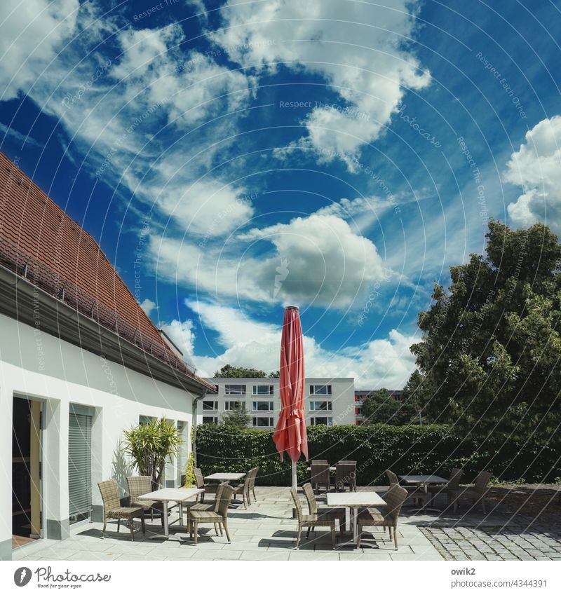 Somewhere Gastronomy Seating chairs tables Empty Appealing Café Sky Clouds Deserted Exterior shot Colour photo Copy Space top Long shot Sunlight Contrast Light
