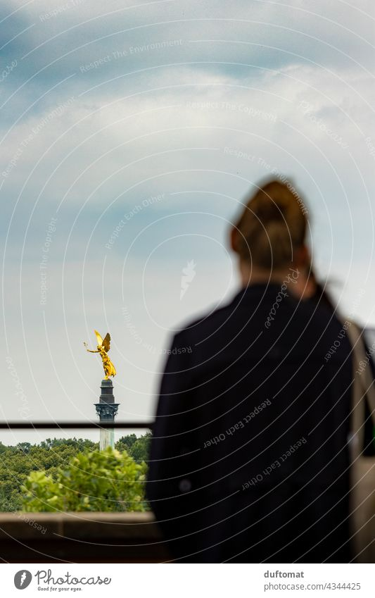 Woman looks at Munich peace angel Tourism Angel Angel of peace Bavaria Gold golden outlook enjoying the view Far-off places Home country Clouds