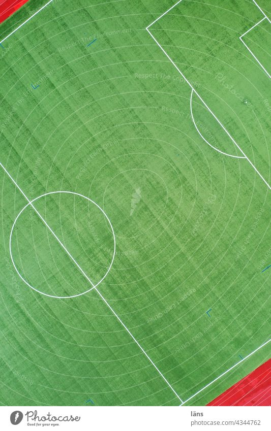 playing field Sporting grounds Green Sports. Colour photo Foot ball Artificial lawn Playing field Running track Lines and shapes from top to bottom UAV view