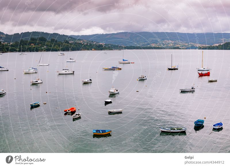 Panoramic view with sailor boats near a small village sea coast summer travel tour tourism blue water port house landscape panorama nature sky building ocean