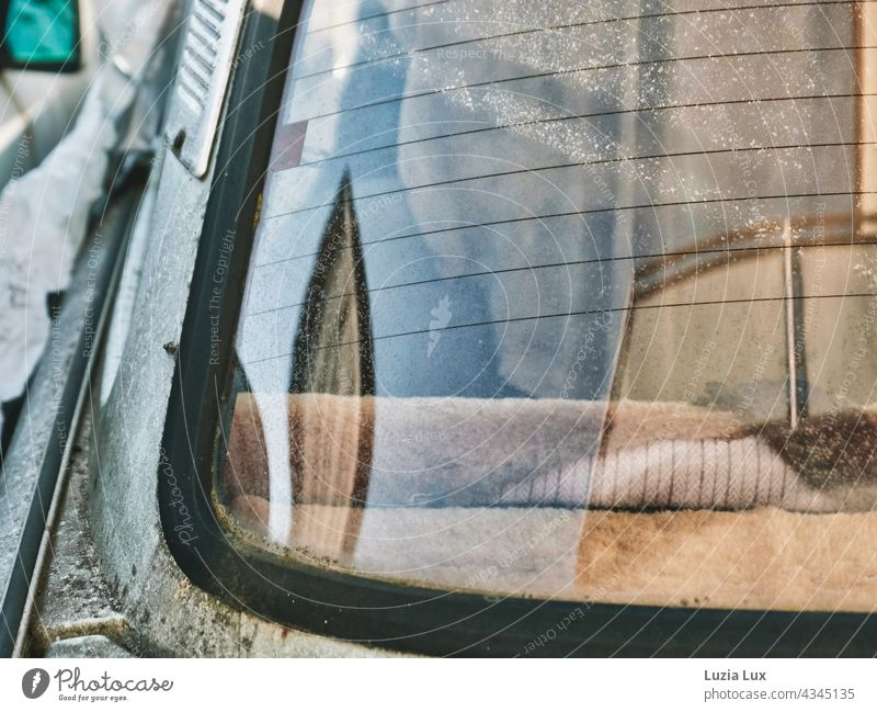 Close-up inside an old Trabant through the window, lights and reflections decay Old car trobant Trabbi Destruction Ravages of time dilapidated Beige Gloomy sad