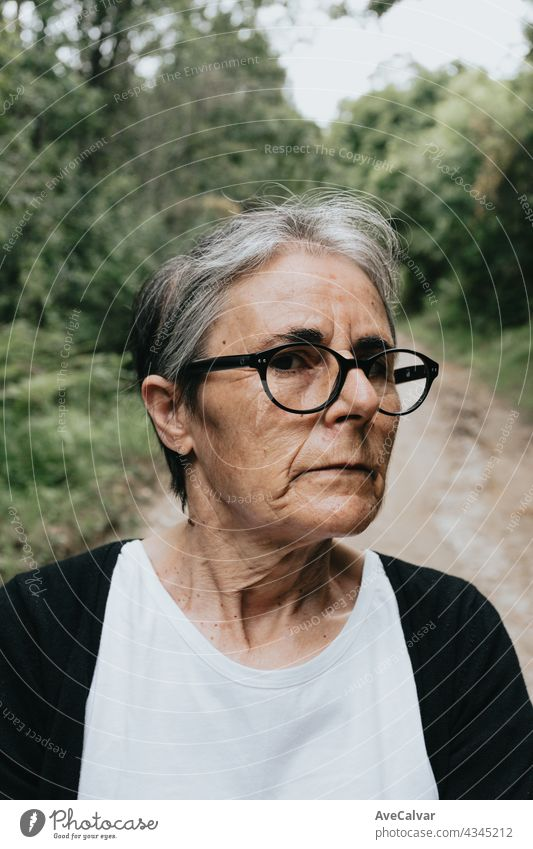 Thoughtful serious anxious mature senior woman, pensive sad lady looking away thinking of loneliness, getting older and depression person age alone bored